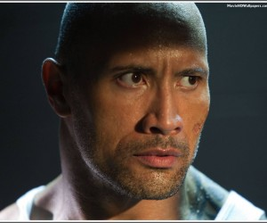Driver (Dwayne Johnson) paces furiously in his cell as he awaits release